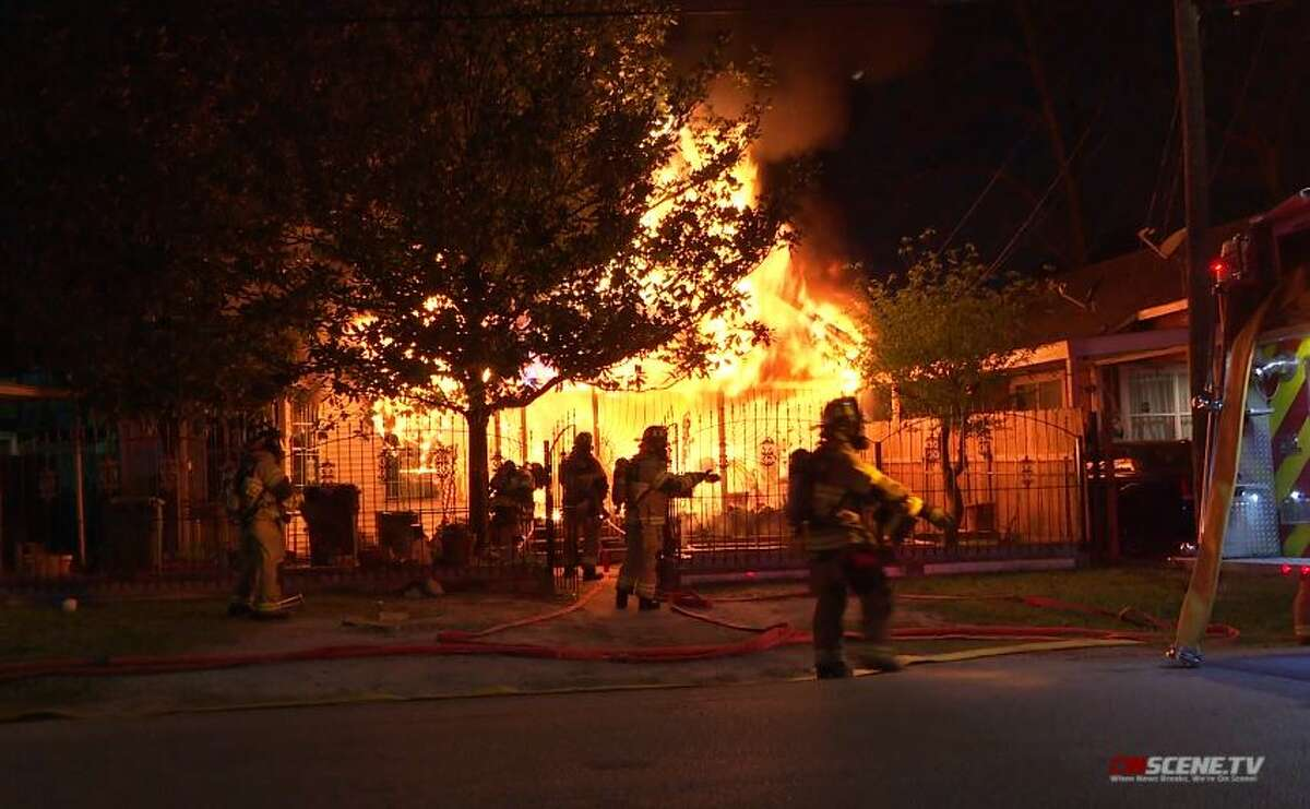 Firefighters battle a fire at a north Houston home on Monday, March 22, 2021.