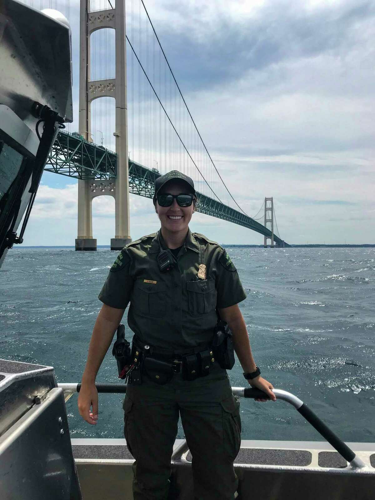 Michigan Conservation Officer Sidney Collins conducts marine patrol on the Straits of Mackinaw. Conservation officers patrol the Great Lakes for marine safety and to monitor the commercial fishing industry. (Courtesy photo/Michigan Department of Natural Resources)