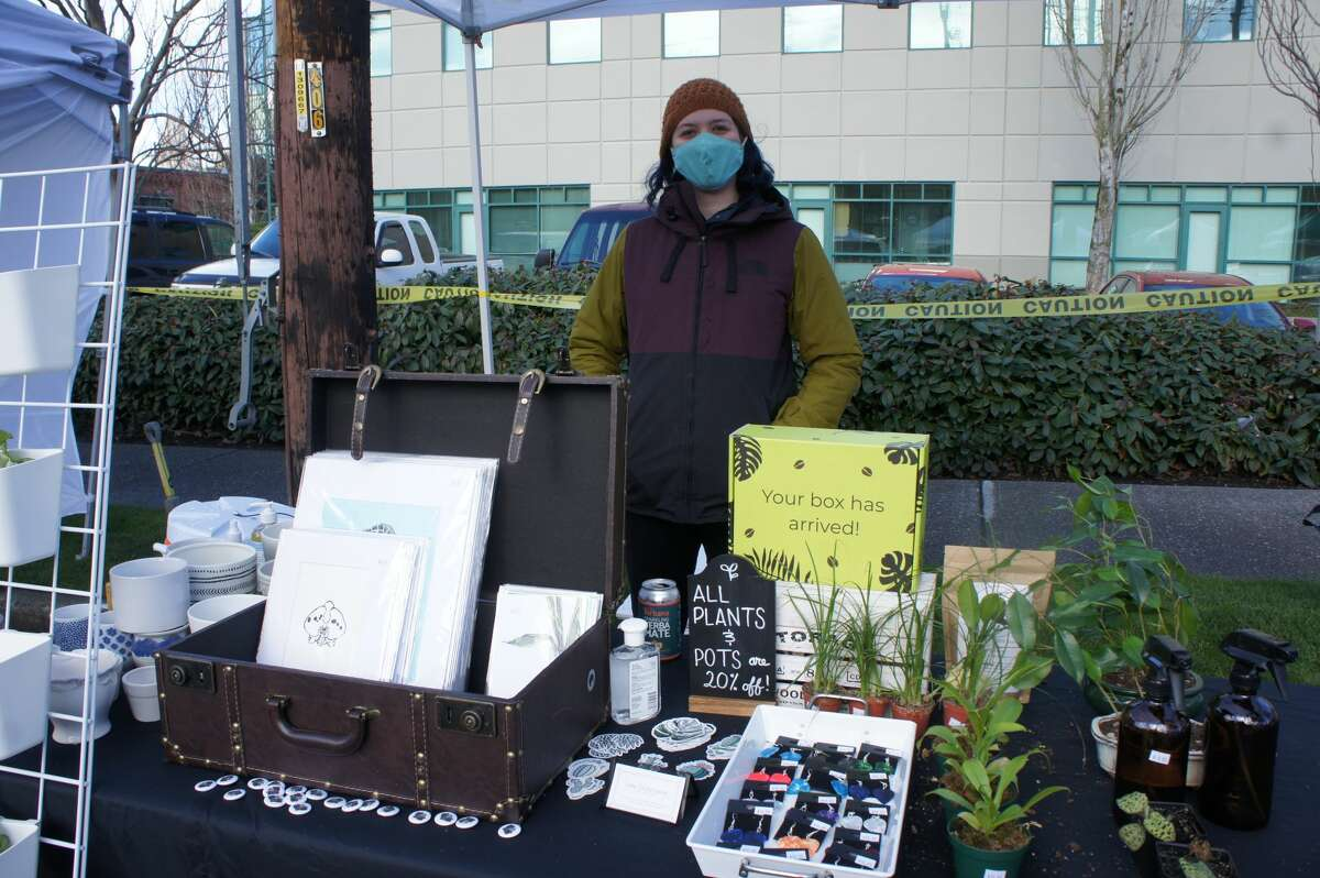 Etaane Newman stands behind her vendor table on the reopening of the Fremont Sunday Market on March 7, 2021.