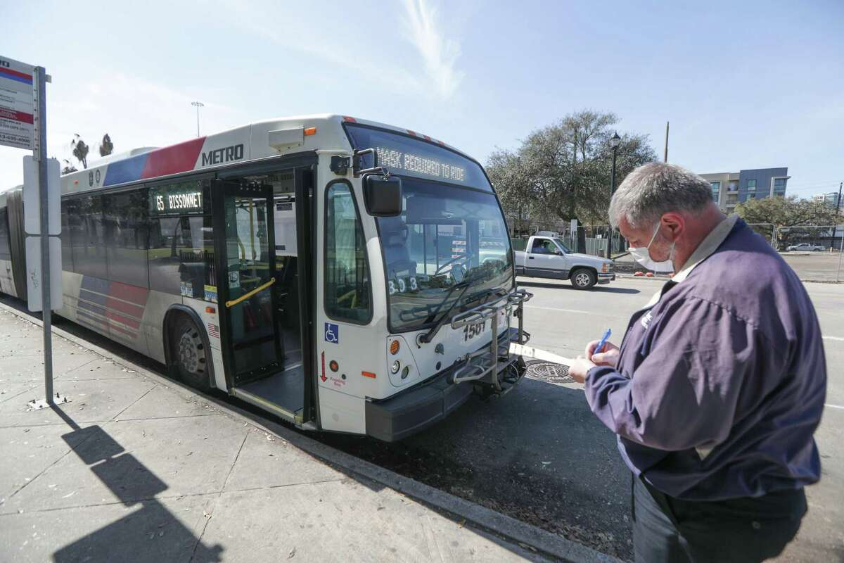 An operator conducts a safety check of a Metropolitan Transit Authority bus at the Wheeler Transit Center on March 3, 2021, in Houston. Transit officials, who scaled back service last year, are preparing to hire operators and mechanics in advance of service increasing in August.