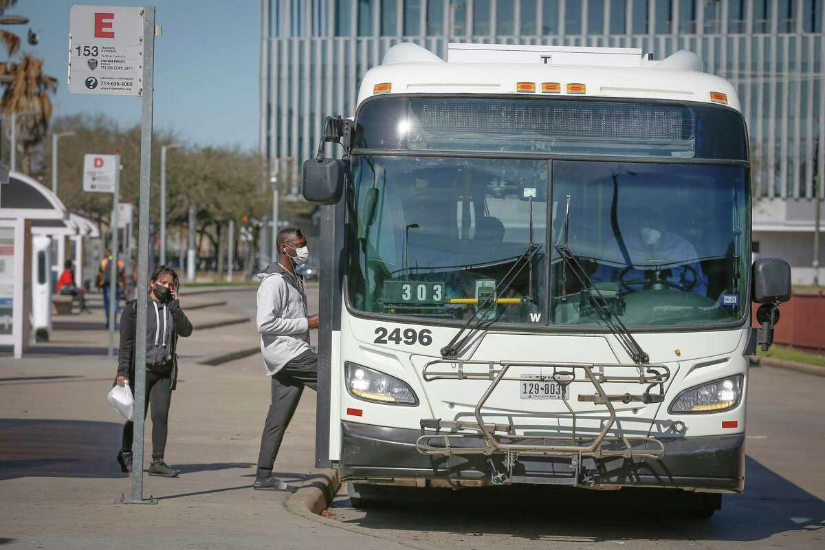 A mask requirement sign flashes on a Metropolitan Transit Authority bus stopped at the Wheeler Transit Center on March 3, 2021, in Houston. Transit officials, who scaled back service last year, are preparing to hire operators and mechanics in advance of service increasing in August.