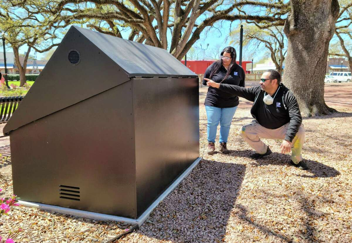 Elia and Noah Quiles of Houston's Up Art Studio look over the fountain control box at League Park. The box is slated to become the first work of art in League City's mini mural program.