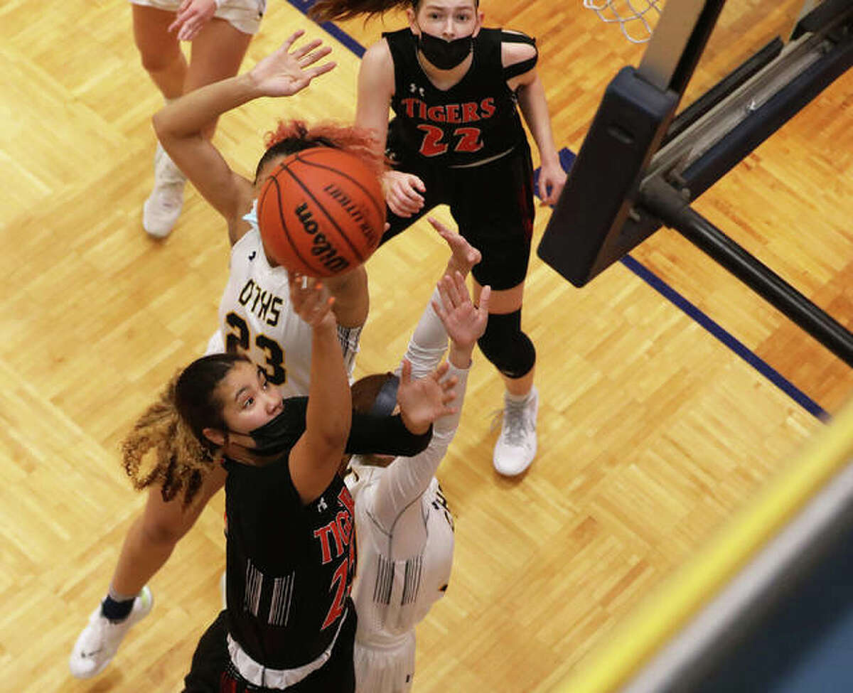 Edwardsville's Sydney Harris scores in traffic on an offensive putback in the first half against O'Fallon during the regular season.