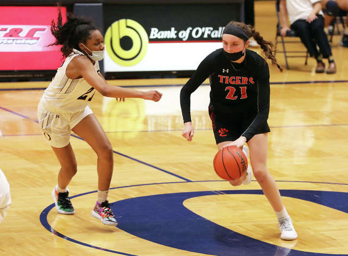Edwardsville's Elle Evans dribbles the ball near center court while being guarded by O'Fallon's Shannon Dowell in the second half of a game in O'Fallon.