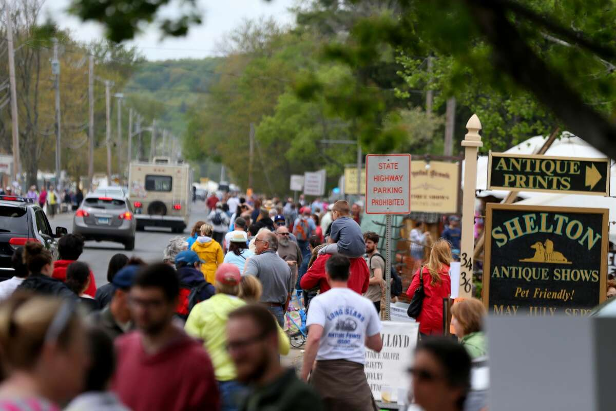 BRIMFIELD, MA - MAY 16: Crowded sidewalks in Brimfield on May 16, 2015, during a flea market weekend.