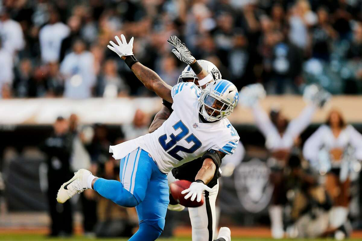 Detroit Lions defensive back Tavon Wilson (32) does not come up with the catch during Week 1 of an NFL Preseason Game against the Oakland Raiders at the Oakland Alameda Coliseum, Friday, Aug. 10, 2018, in Oakland, Calif.
