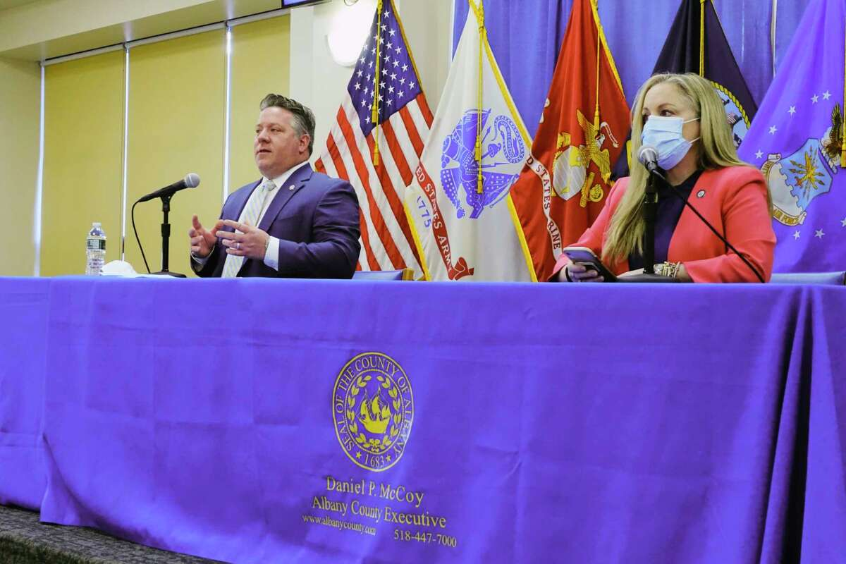 Albany County Executive Dan McCoy, left, and Albany County Department of Health Commissioner Dr. Elizabeth Whalen, take part in a press conference to discuss Covid-19 cases and vaccinations on Monday, March 22, 2021, in Albany, N.Y. (Paul Buckowski/Times Union)