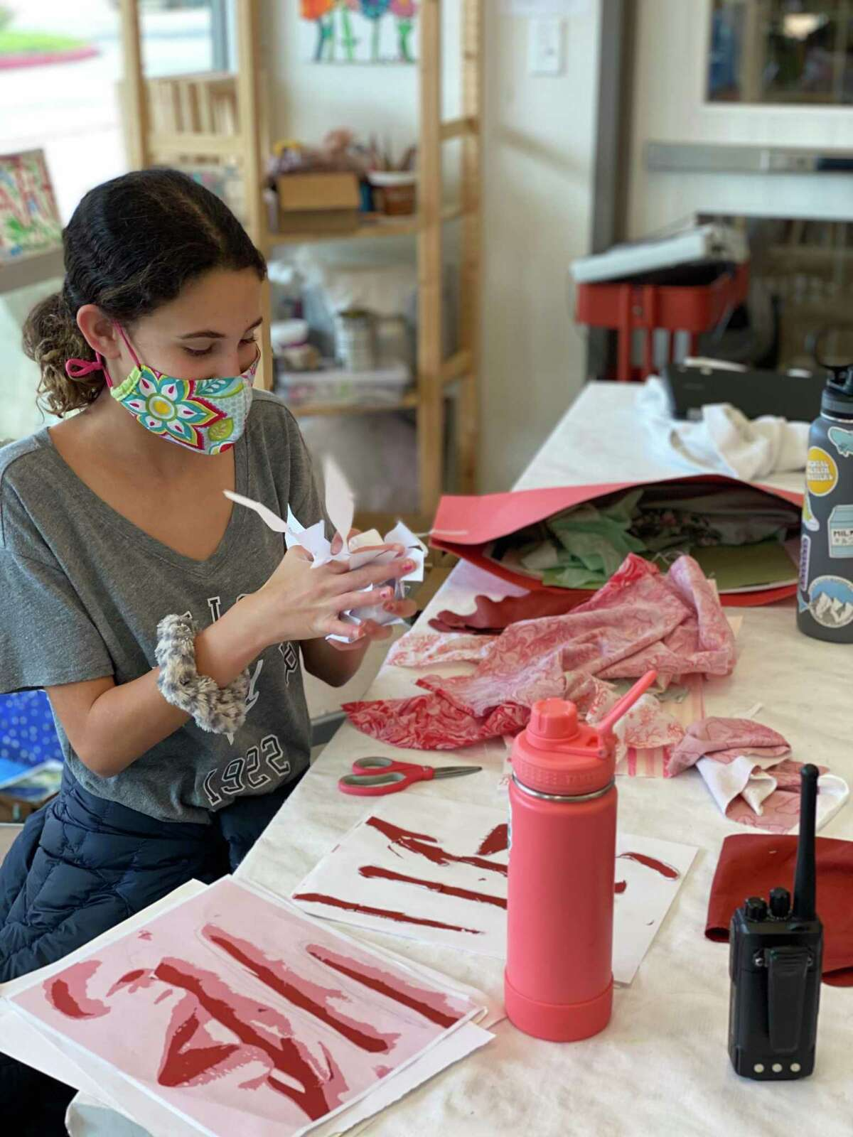 """Eighth grader Addison Young works on her mixed media piece """"It's Not That I Don't Want to Listen"""" at the WIDE School in Missouri City. She won a Gold Key in the Scholastic Art & Writing Awards."""