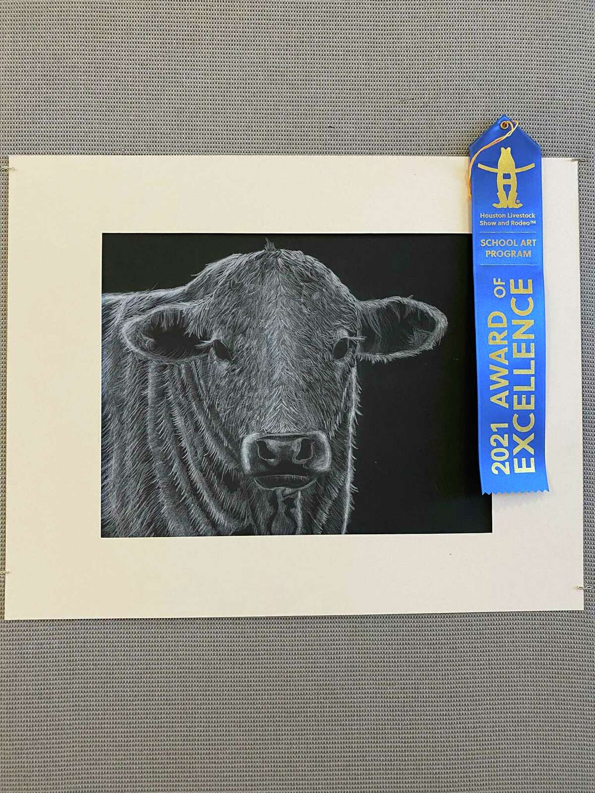 """WIDE School fifth grader Ryan Kuo's """"Moo"""" won a Best of Show in the Houston Livestock Show & Rodeo Art Program. The monochromatic drawing went on to auction."""