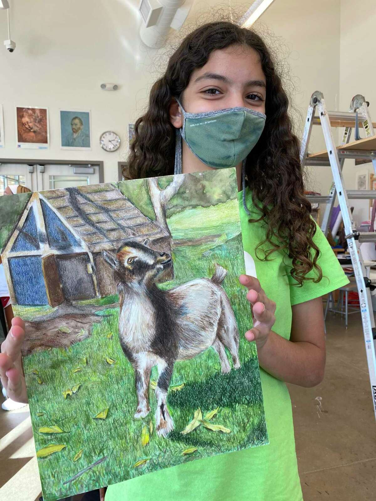 WIDE School sixth grader Luna Baba shows off her Best of Show piece from the rodeo art program.