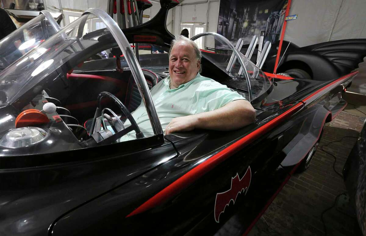 """Collector Bob Wills sits in a reproduction of the Batmobile featured in the 1960s """"Batman"""" television series. The car - in addition to another Batmobile and a Batcycle - is among the vehicles in his collection that are on display in """"Movie Metal."""" The pop-up exhibit at the San Antonio Museum of Art can be seen through April 11."""