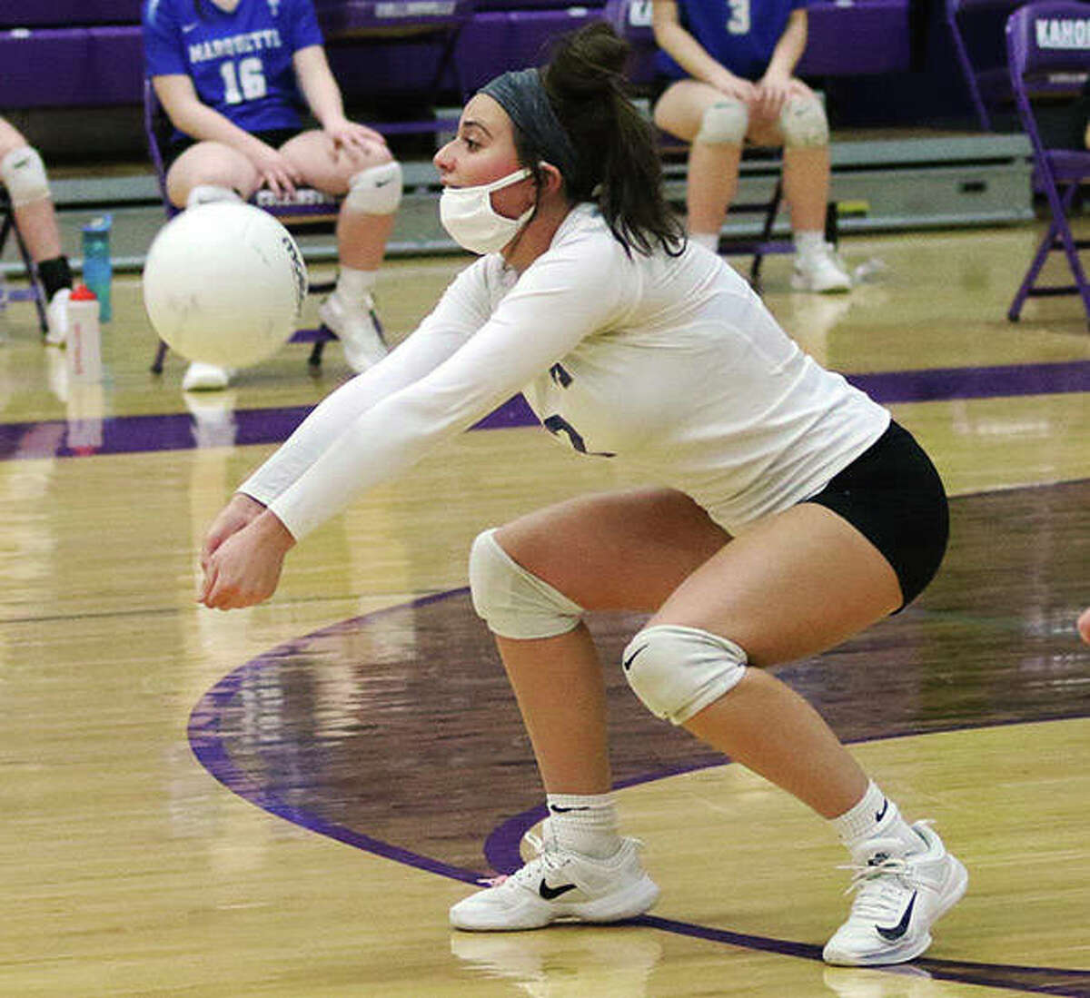 Marquette libero Ellie Jacobs receives a serve during a two-set victory over the host Kahoks on Wednesday at Fletcher Gym in Collinsville.