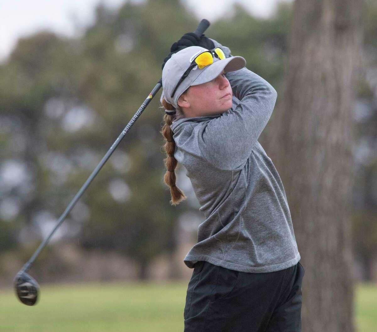 Lee High's Sarah Reed follows her shot 03/22/21 during the District 2-6A tournament at Ranchland Hills Golf Club. Tim Fischer/Reporter-Telegram