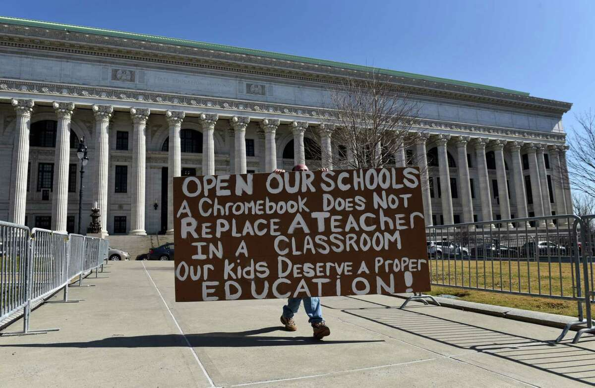 Capital Region school parents gathered in West Capitol Park to urge lawmakers to change social distancing rules to conform with new CDC guidance so schools can reopen on Monday, March 22, 2021, in Albany, N.Y. (Will Waldron/Times Union)