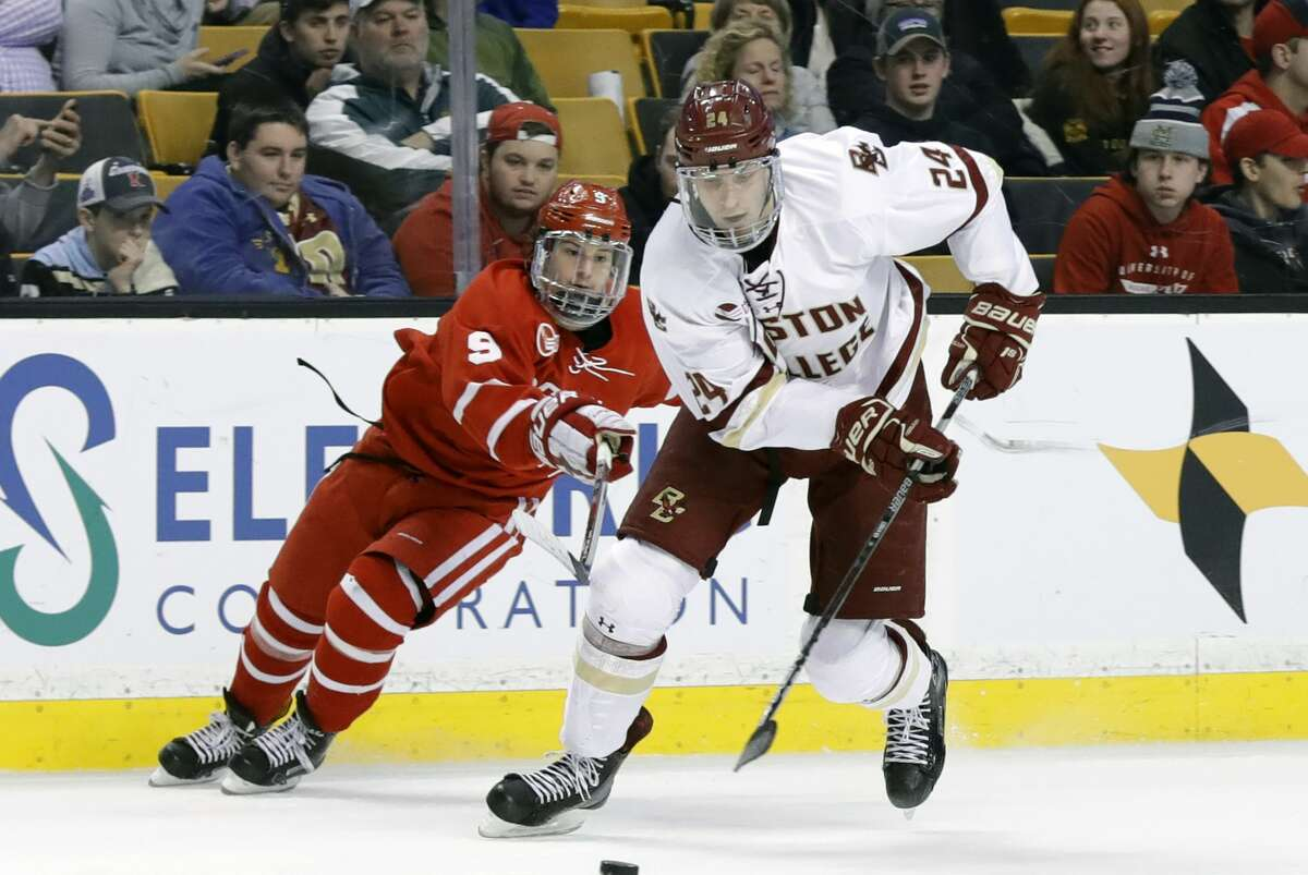 Boston University captain Logan Cockerill (9), shown here in a 2018 game against Boston College, says the fact that the Terriers played only 15 games shouldn't make any difference in the NCAA hockey Albany regional, which begins Saturday, March 27, 2021. (Photo by Fred Kfoury III/Icon Sportswire via Getty Images)