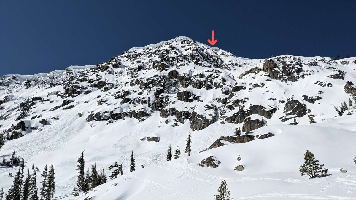 """The Sierra Avalanche Center shared an image showing the the slope the victim fell down on March 20, 2021. """"The arrow is where the person broke the cornice,"""" the center wrote in a statement."""
