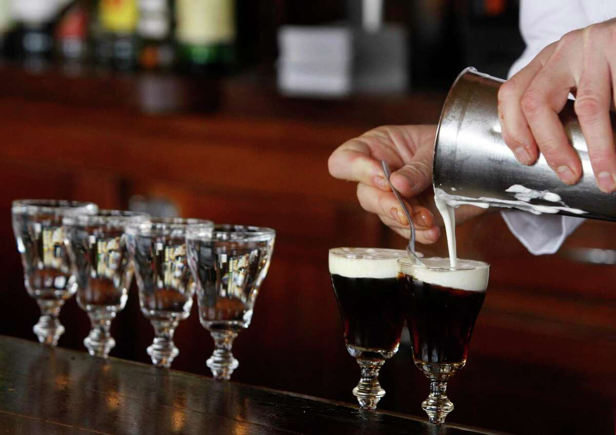 Bartender Paul Nolan adds cream to Irish coffees at the Buena Vista Cafe in San Francisco in 2011, when the restaurant was thriving. Bob Freeman, the cafe's owner, was given a grant from the Small Business Administration for pandemic relief that was rescinded.