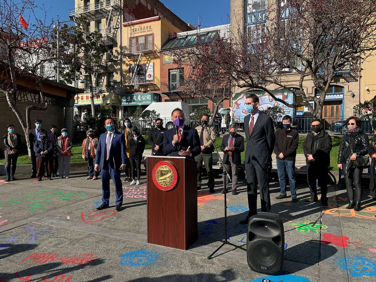 A group of elected officials and Asian American community leaders gathers in Portsmouth Square, at the heart of San Francisco's Chinatown neighborhood, to denounce recent attacks against people of Asian descent.