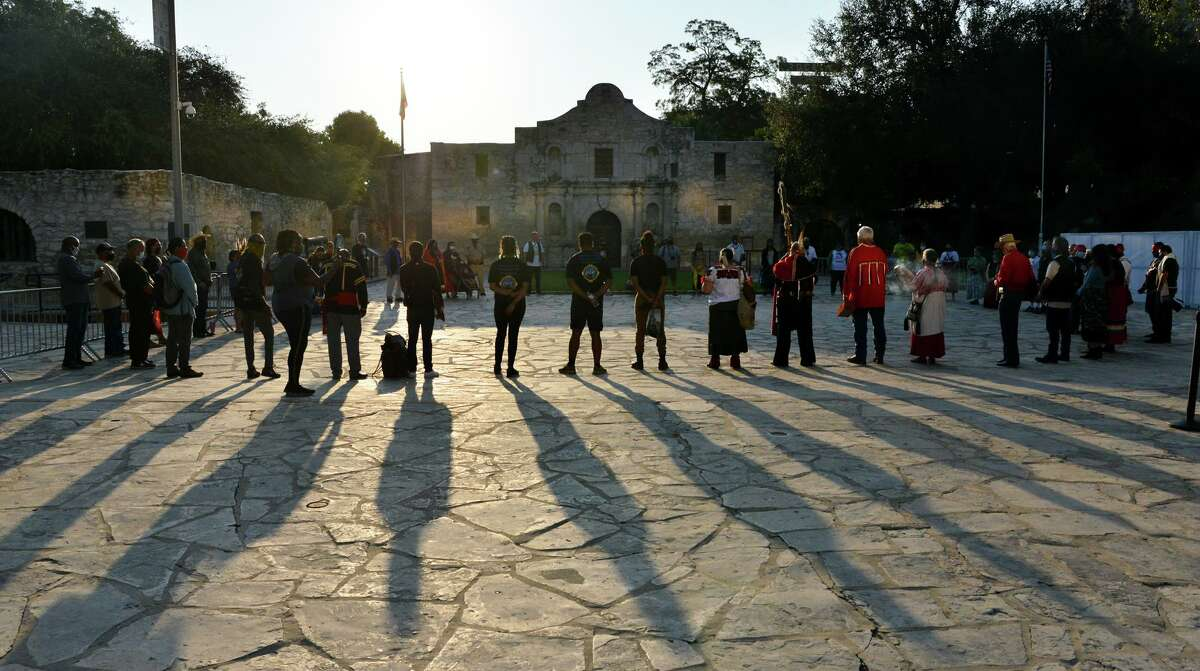 Members of the Tap Pilam Coahuiltecan Nation pause in silence during their 25th annual sunrise ceremony and run in front of the Alamo to honor ancestors buried inside the mission-era church in September 2020. Tap Pilam has appealed its federal lawsuit claiming the Indigenous group's constitutional religious rights have been denied by the Alamo Trust. The group says it has not been allowed to hold its annual remembrance ceremony in the church, to remember ancestors whose remains were re-interred in 1995, and has been excluded from the human remains protocol at the historic battle and Spanish-Indigenous mission site.