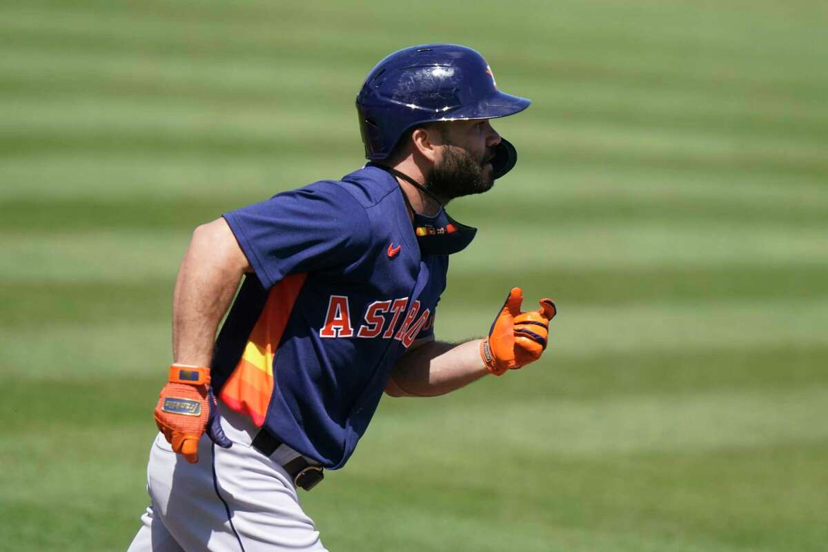 Houston Astros' Jose Altuve runs the bases after hitting a triple during the first inning of a spring training baseball game against the St. Louis Cardinals, Sunday, March 7, 2021, in Jupiter, Fla. (AP Photo/Lynne Sladky)