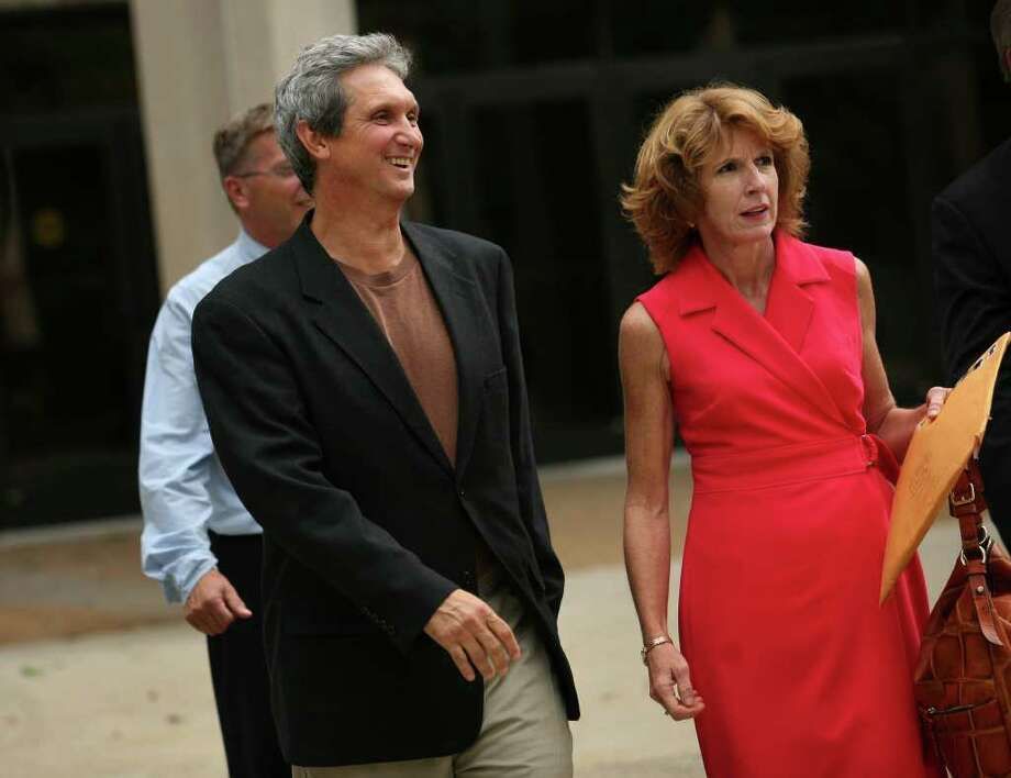 Accompanied by his wife Diane, Danbury Hospital ex-CFO William Roe, 56 of Wilton, leaves the federal courthouse in Bridgeport after being released on bail, Thursday afternoon, September 9, 2010. The former treasurer plead not guilty to defrauding the hospital and another former employer of nearly $200,000. Photo: Brian A. Pounds / Connecticut Post