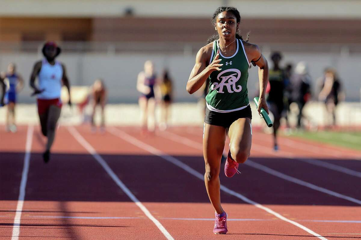 Reagan's Jasmine Montgomery finishes first in the 400-meter relay at the T-Bird Relays on March 18.