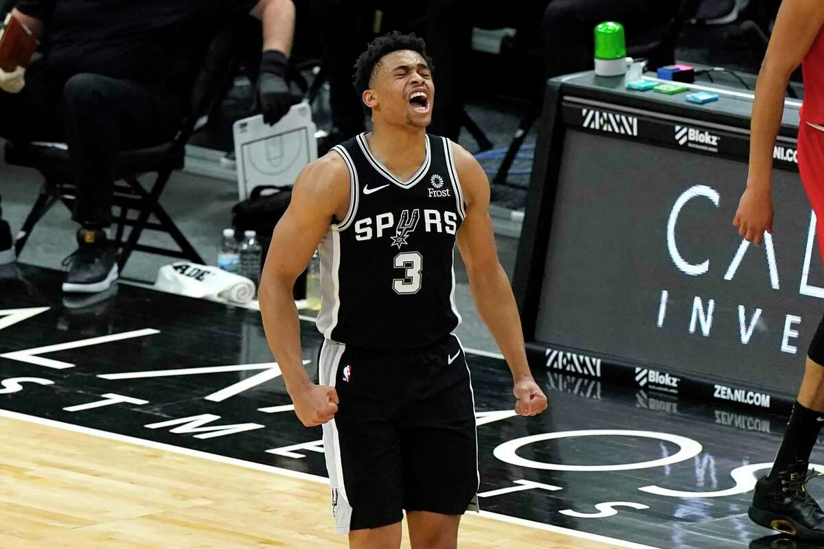 San Antonio Spurs forward Keldon Johnson reacts after making a three-point basket during the second half of an NBA basketball game against the Chicago Bulls in Chicago, Wednesday, March 17, 2021. The Spurs won 106-99. (AP Photo/Nam Y. Huh)