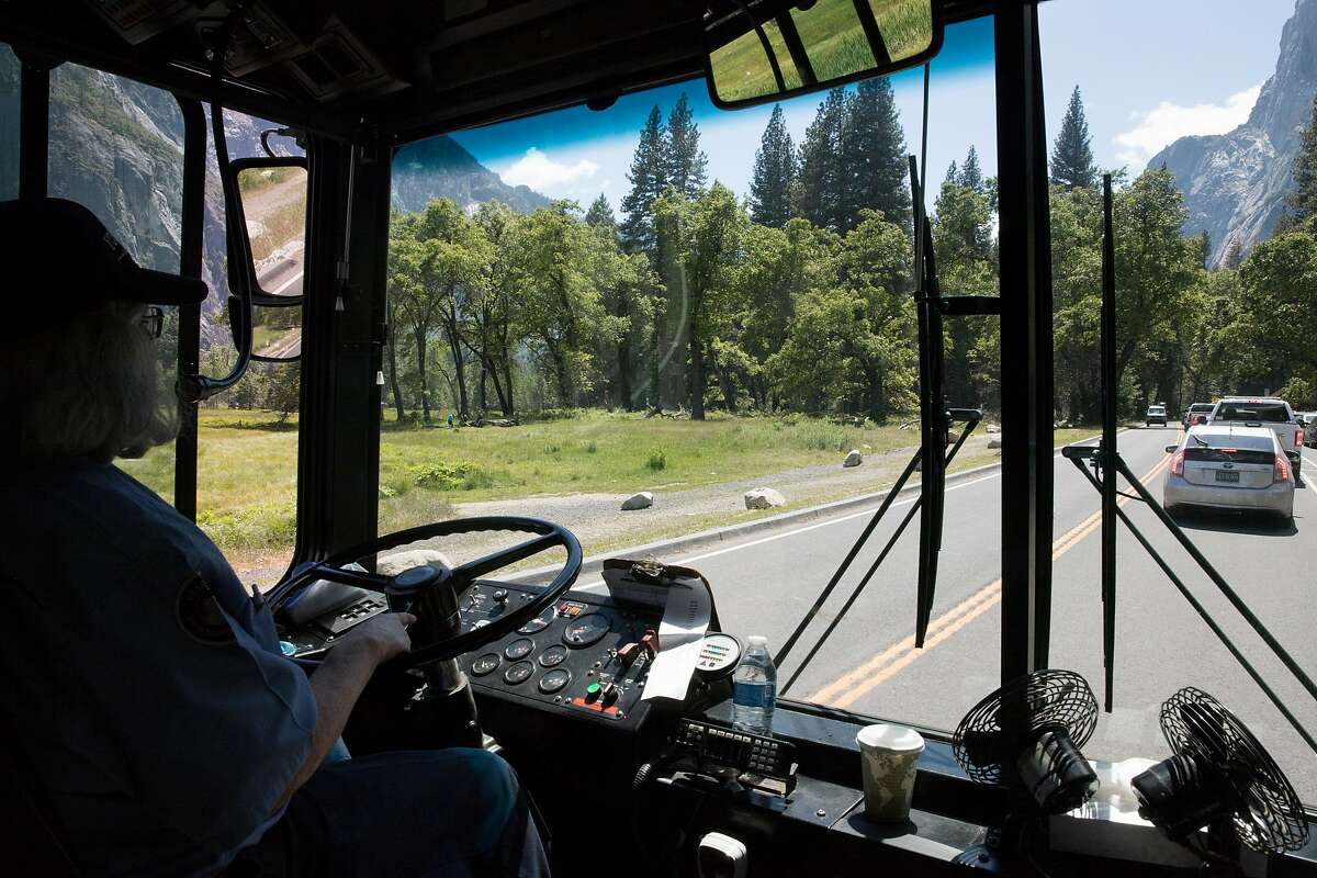 Bus driver Loretta Dooley navigates a crowded shuttle bus through Yosemite Valley in May 2019.