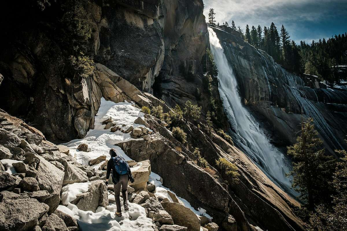 In February, Mark Elmore of Virginia picks his way through snow and rocks on the Mist Trail in Yosemite National Park.