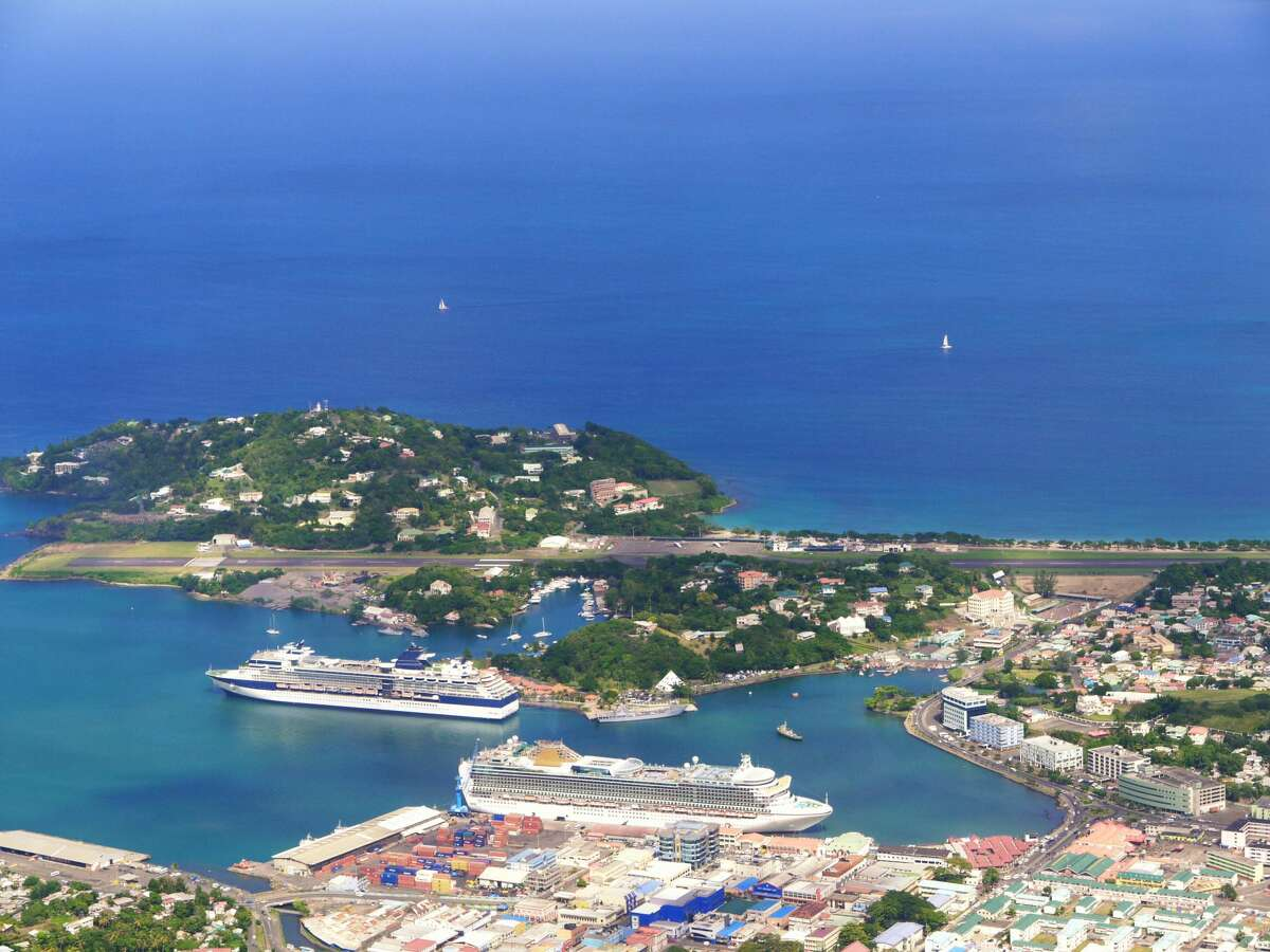 Aerial view of docks and airstrip with cruise ships and yatchs in bay at Pointe Seraphine, Castries, Saint Lucia.