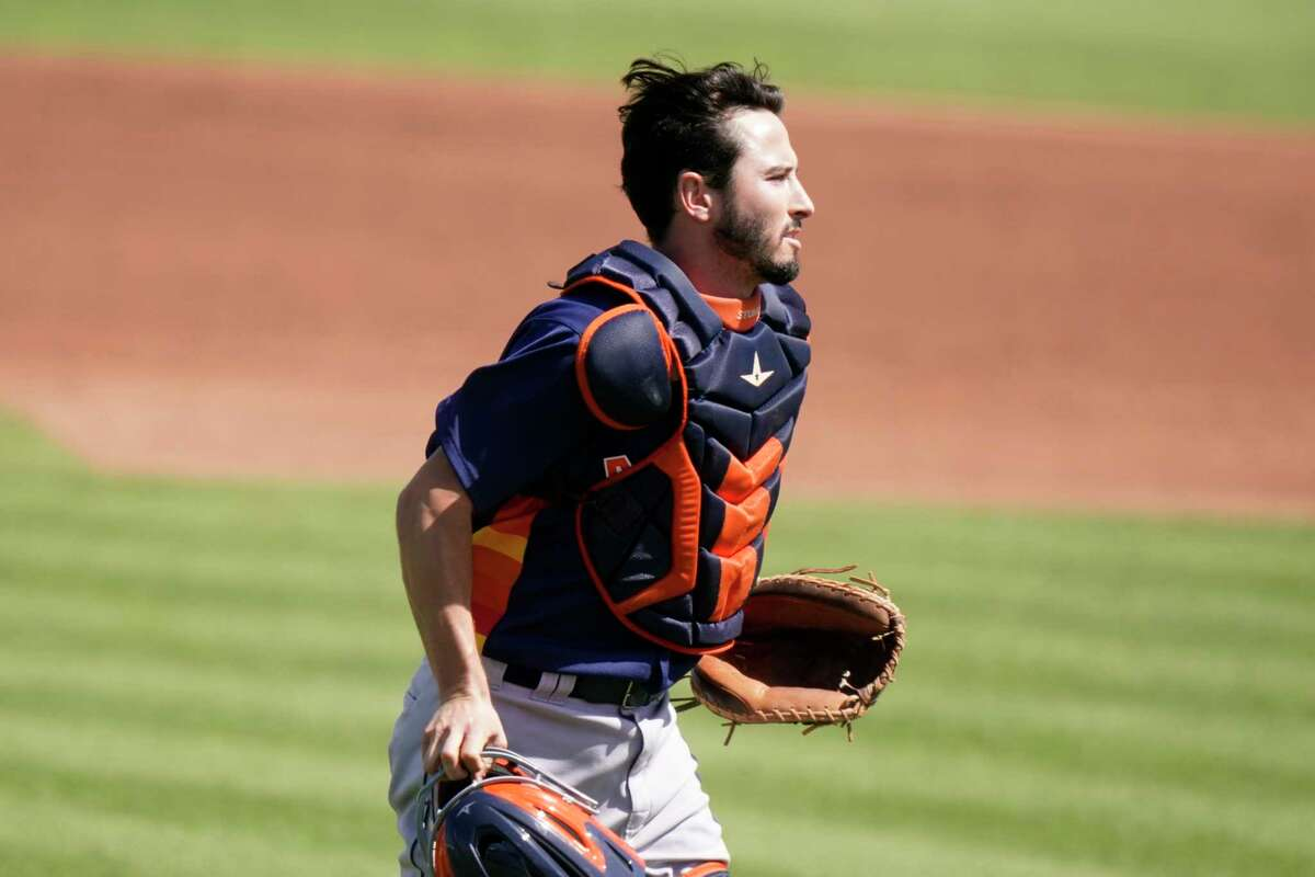 Houston Astros catcher Garrett Stubbs works during a spring training baseball game against the St. Louis Cardinals, Sunday, March 7, 2021, in Jupiter, Fla. (AP Photo/Lynne Sladky)