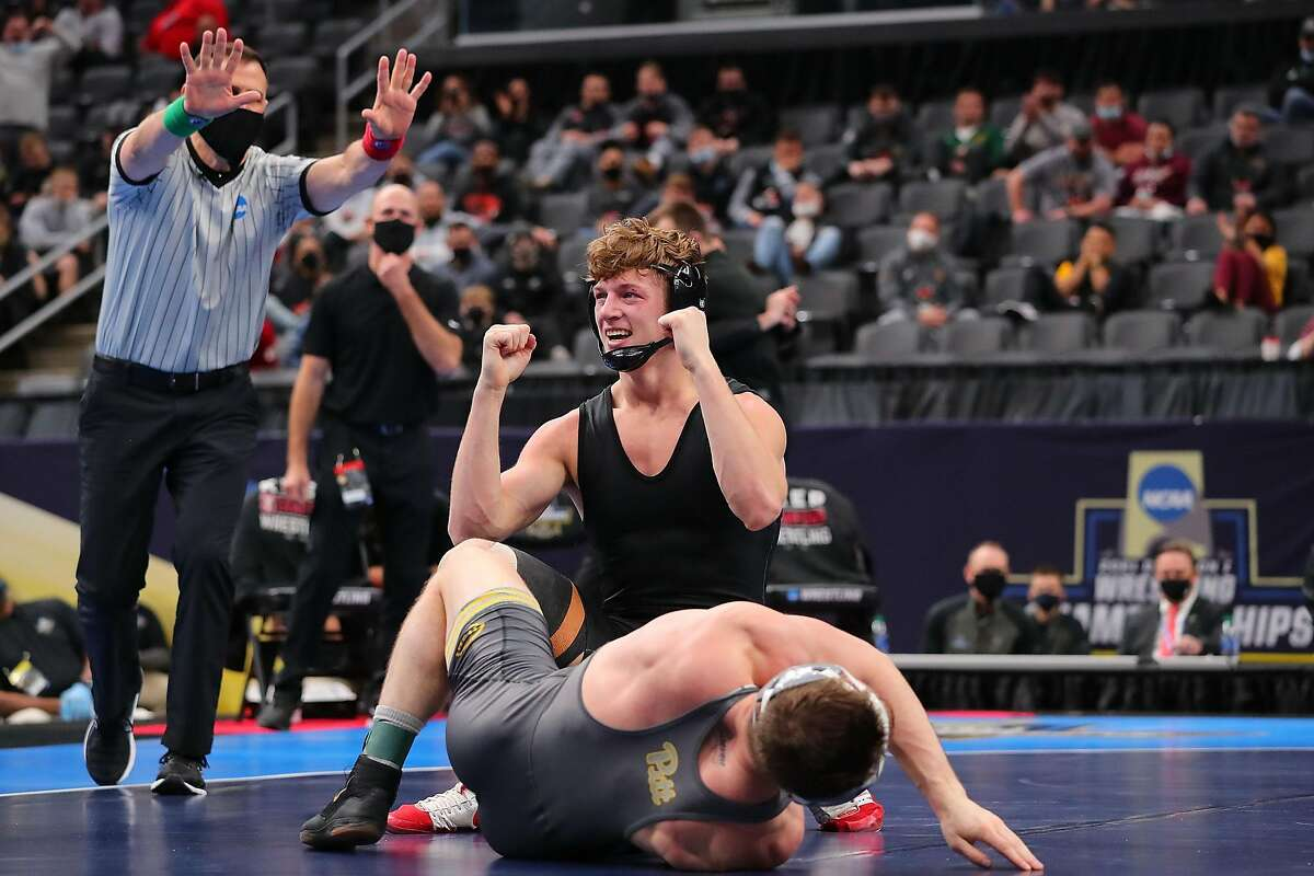 ST LOUIS, MO - MARCH 20: Shane Griffith of Stanford celebrates after beating Jake Wentzel in the 165lb weight class in the first-place match during the NCAA Division I Men's Wrestling Championship at the Enterprise Center on March 20, 2021 in St Louis, Missouri. (Photo by Dilip Vishwanat/Getty Images)