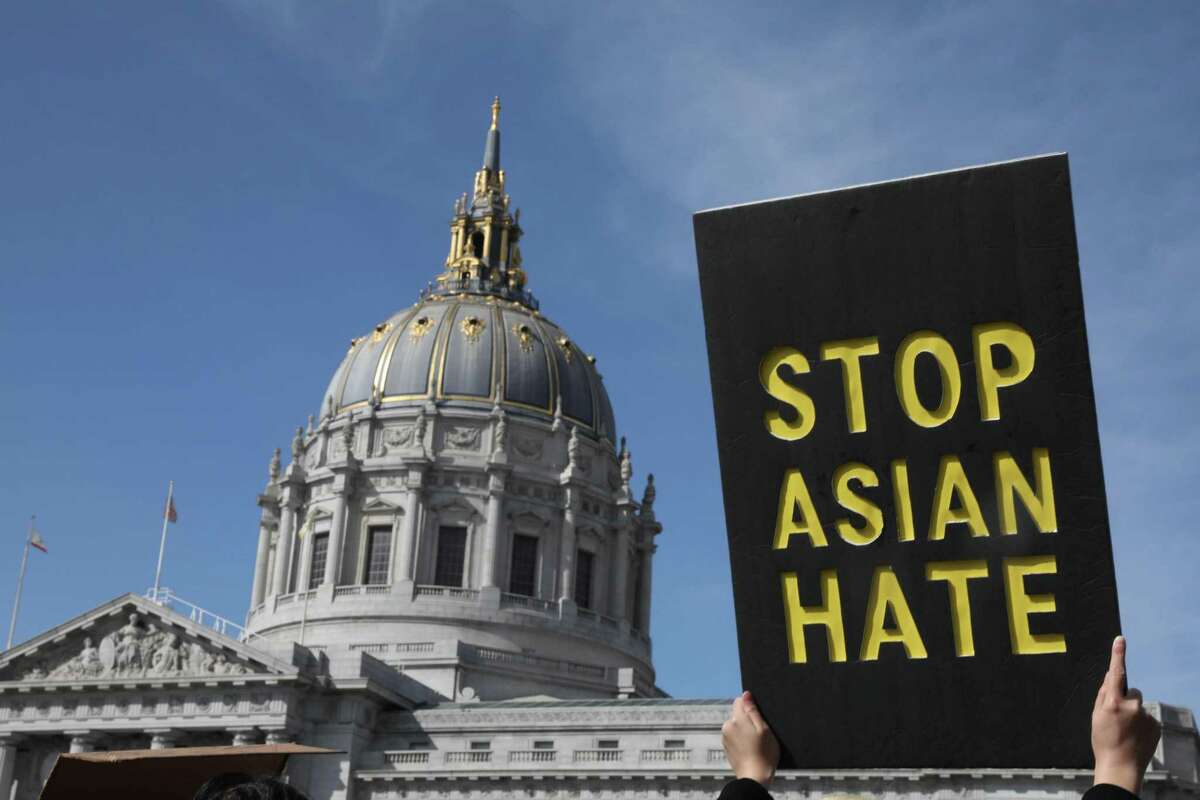 A demonstrator holds a sign saying Stop Asian Hate as they march toward City Hall after rallying in front of the Hall of Justice on March 22, 2021 in San Francisco.
