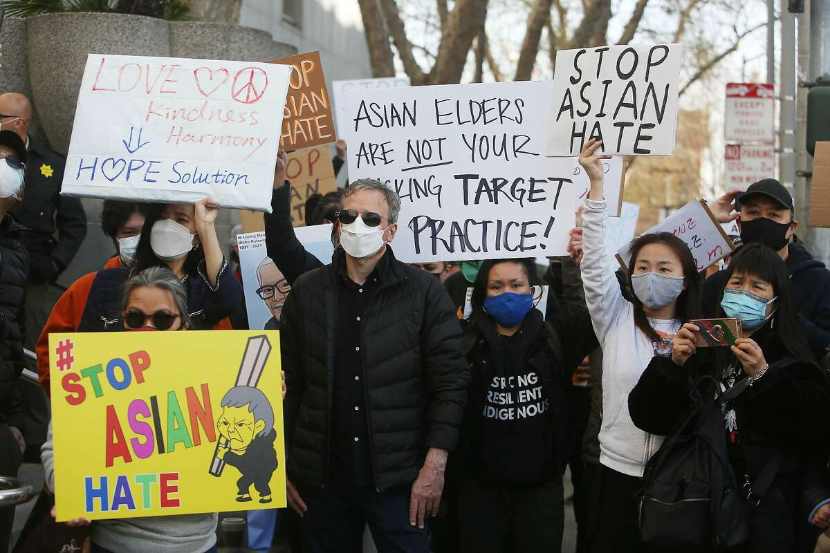 Demonstrators rally in front of the Hall of Justice as they demand justice for Vicha Ratanapakdee on Thursday, March 22, 2021 in San Francisco, Calif. Vicha Ratanapakdee died after being pushed to the pavement as he walked through the city's Anza Vista neighborhood.