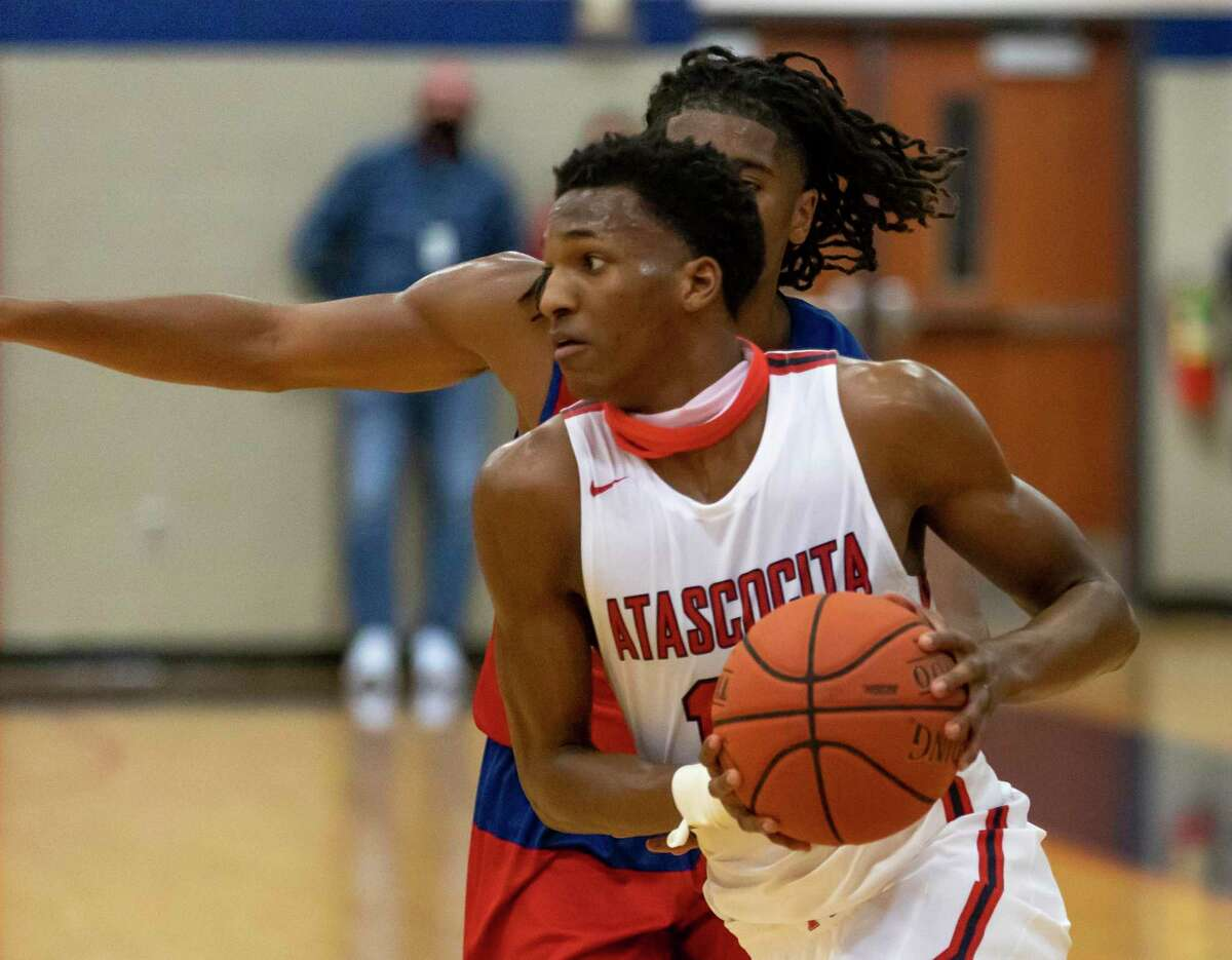 Atascocita point guard Justin Collins (13) passes the ball during the fourth quarter of a District 21-6A basketball game against Westbrook at Atascocita High School, Wednesday, Jan. 13, 2021, in Humble.