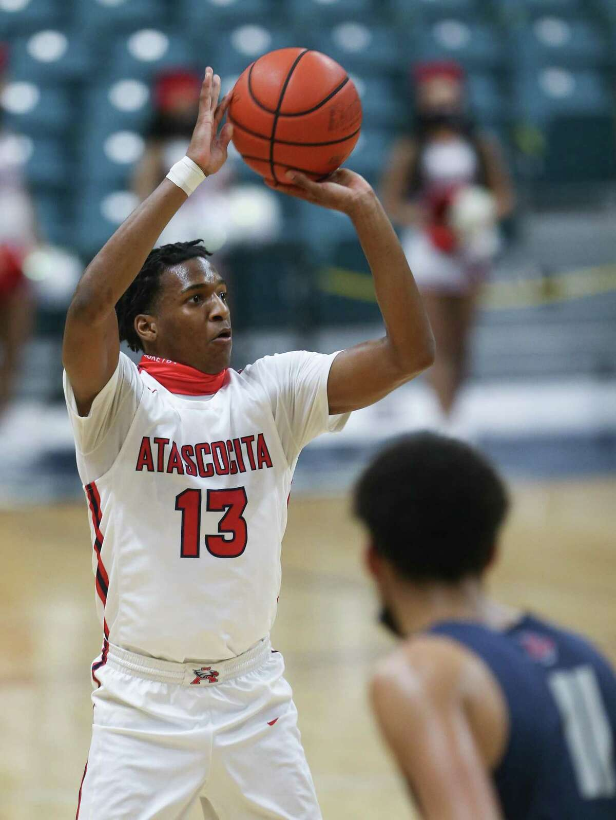 Atascocita guard Justin Collins (13) puts up a shot against reacts Dawson during 6A regional quarterfinals playoff game at Merrell Center in Katy on Saturday, Feb. 27, 2021. Atascocita won the game 55-54.