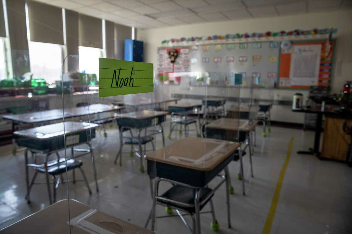 STAMFORD, CONNECTICUT - MARCH 10: Plastic dividers stand on classroom desks, due to pandemic protocols, before the first day of in-person learning for five days per week at Stark Elementary School on March 10, 2021 in Stamford, Connecticut. Stamford Public Schools, like many school districts nationwide, are returning to full time in-school learning as pandemic restrictions begin to ease. The district had been operating on a hybrid model for most of the school year. (Photo by John Moore/Getty Images)