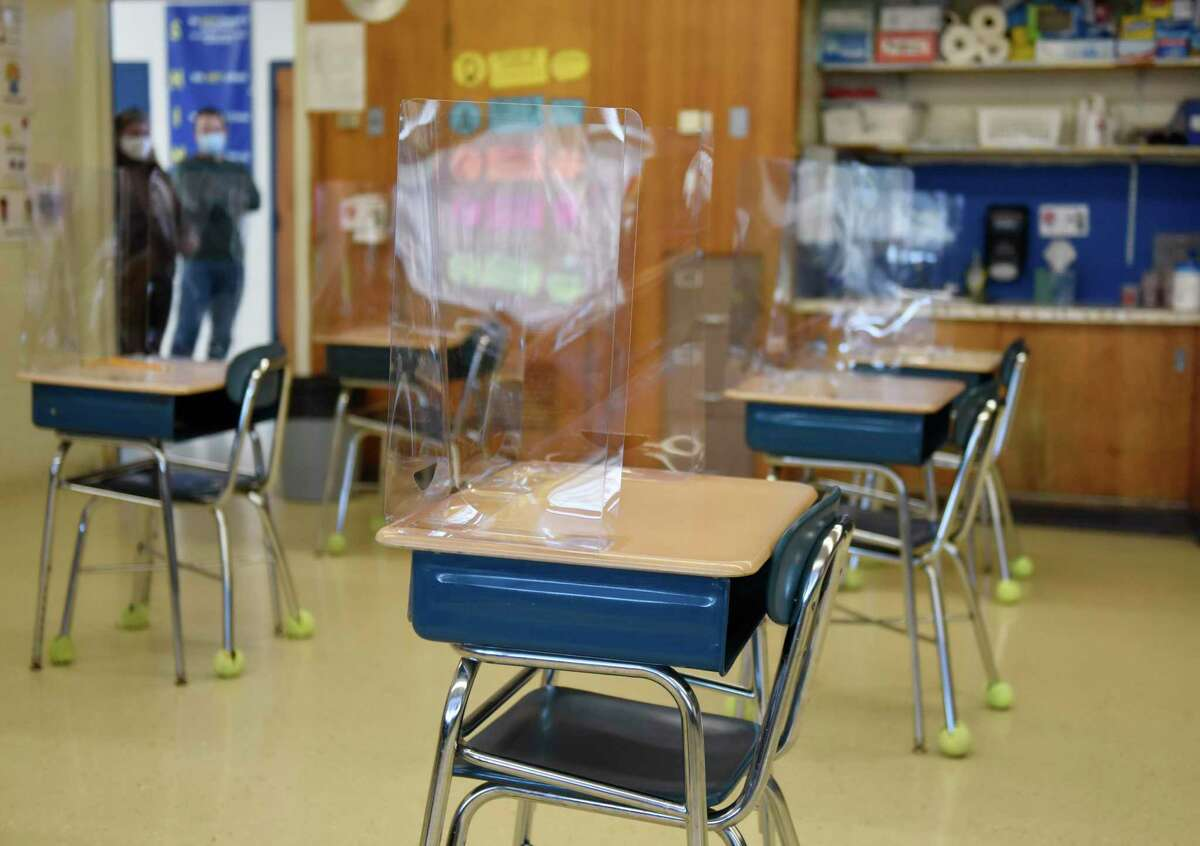 Classrooms are set up with COVID-19 precautions in place as students prepare to return five days-a-week at Northeast Elementary School in Stamford, Conn. Monday, March 8, 2021. For the first time in about a year, elementary students will return to full-time in-person learning starting Tuesday.