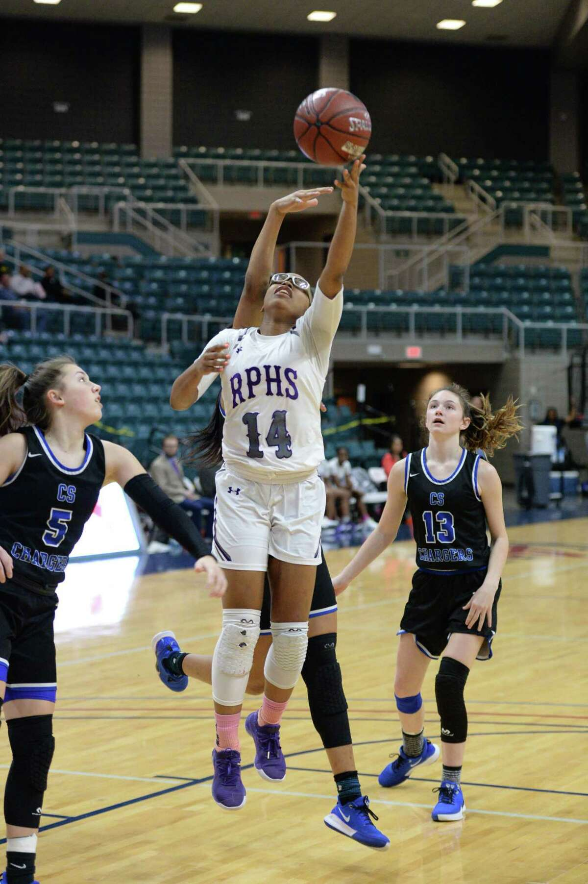 Aleighyah Fontenot (14) of Ridge Point drives for a lay-up during the first quarter of a Girls 6A Region III semifinal play-off game between the Ridge Point Panthers and the Clear Springs Chargers on Friday, February 28, 2020 at the Leonard Merrell Center, Katy, TX.