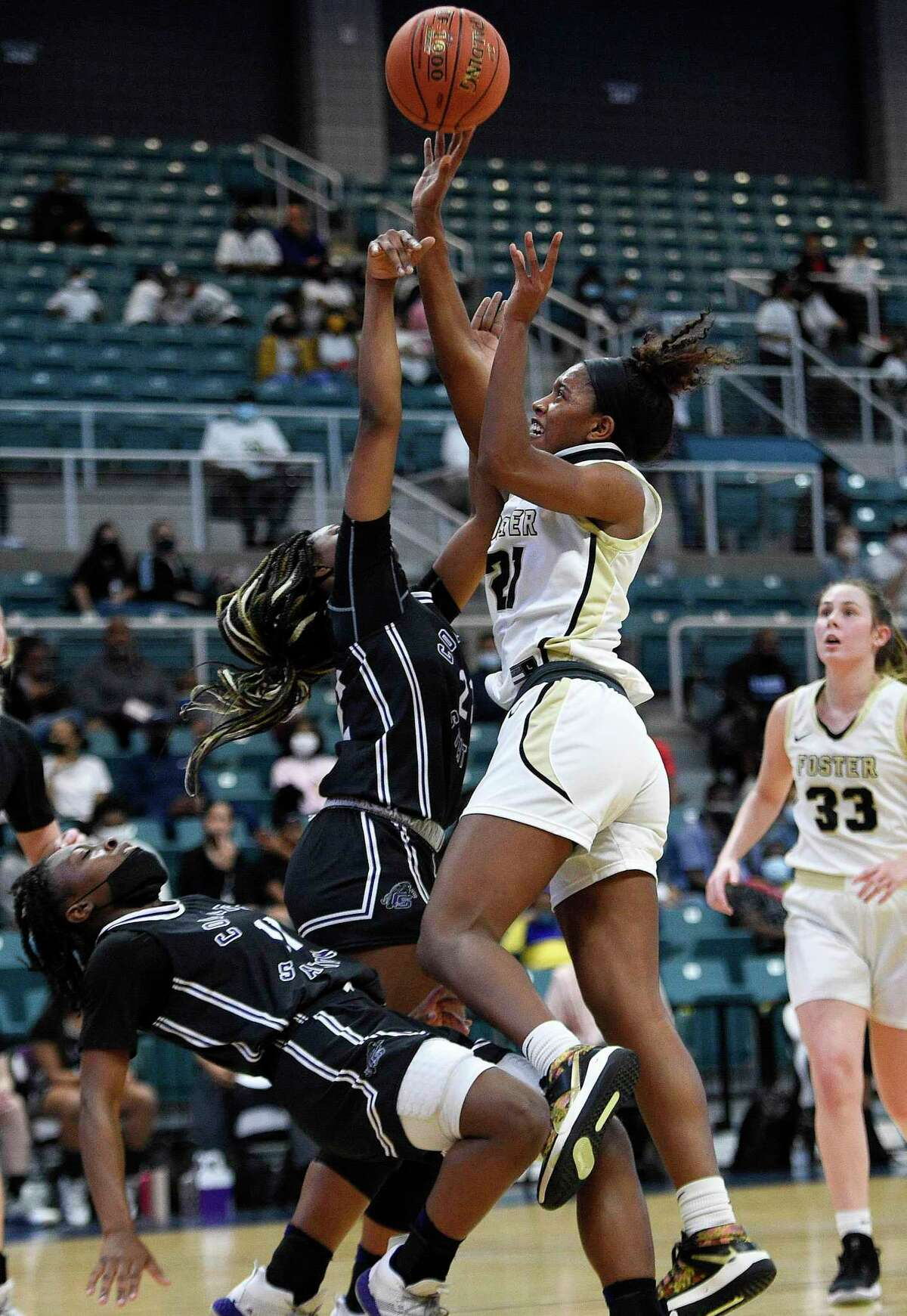 Foster's Kaiya Wynn, right, shoots as College Station's Jayden Davenport, left, defends during the first half of a 5A Region III semifinal high school basketball playoff game, Friday, Feb. 26, 2021, in Katy, TX.