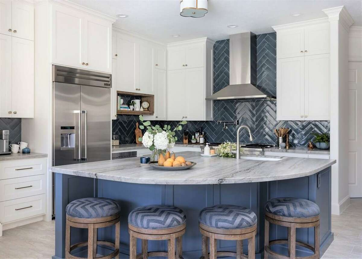 Lorena and Terry Kubera opted for a major remodel of the kitchen in their 20-year-old home in The Woodlands. They removed a wall with an arched doorway and installed a new island closer to other work spaces.