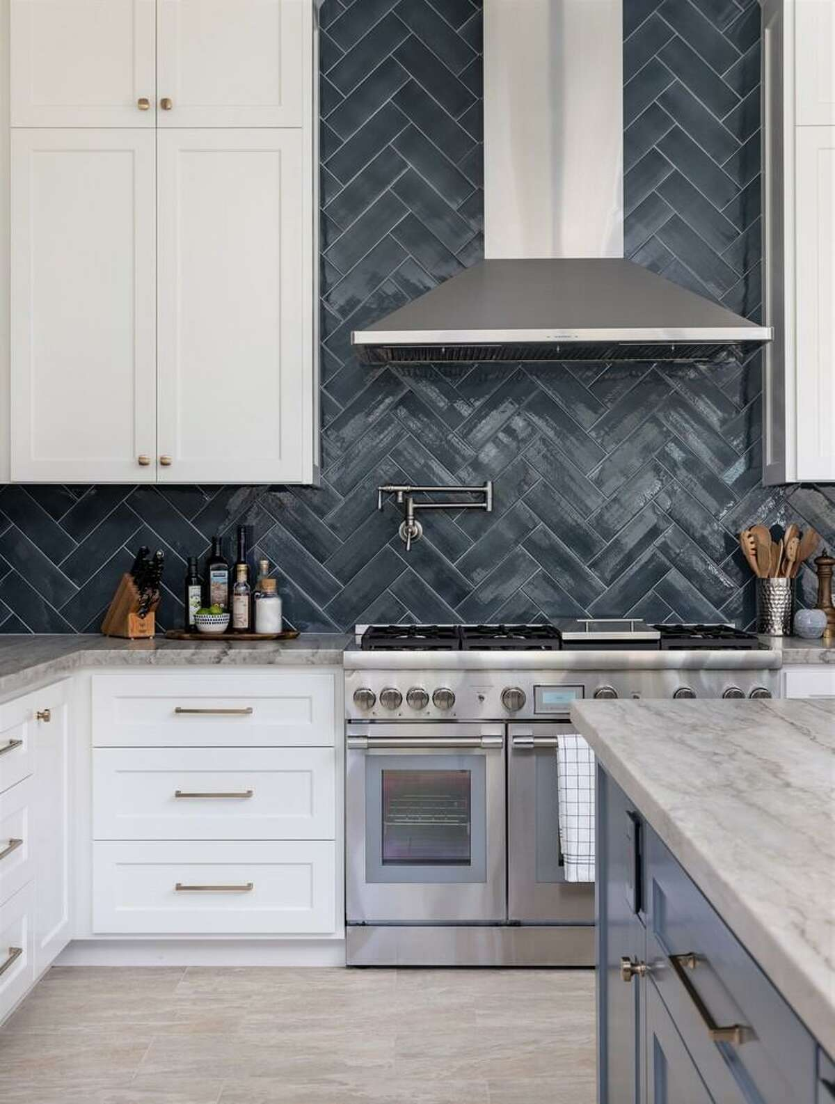 """Ann Sacks ceramic tile and Sherwin-Williams """"Slate Tile"""" paint on the island add a big dose of dark blue to the kitchen."""