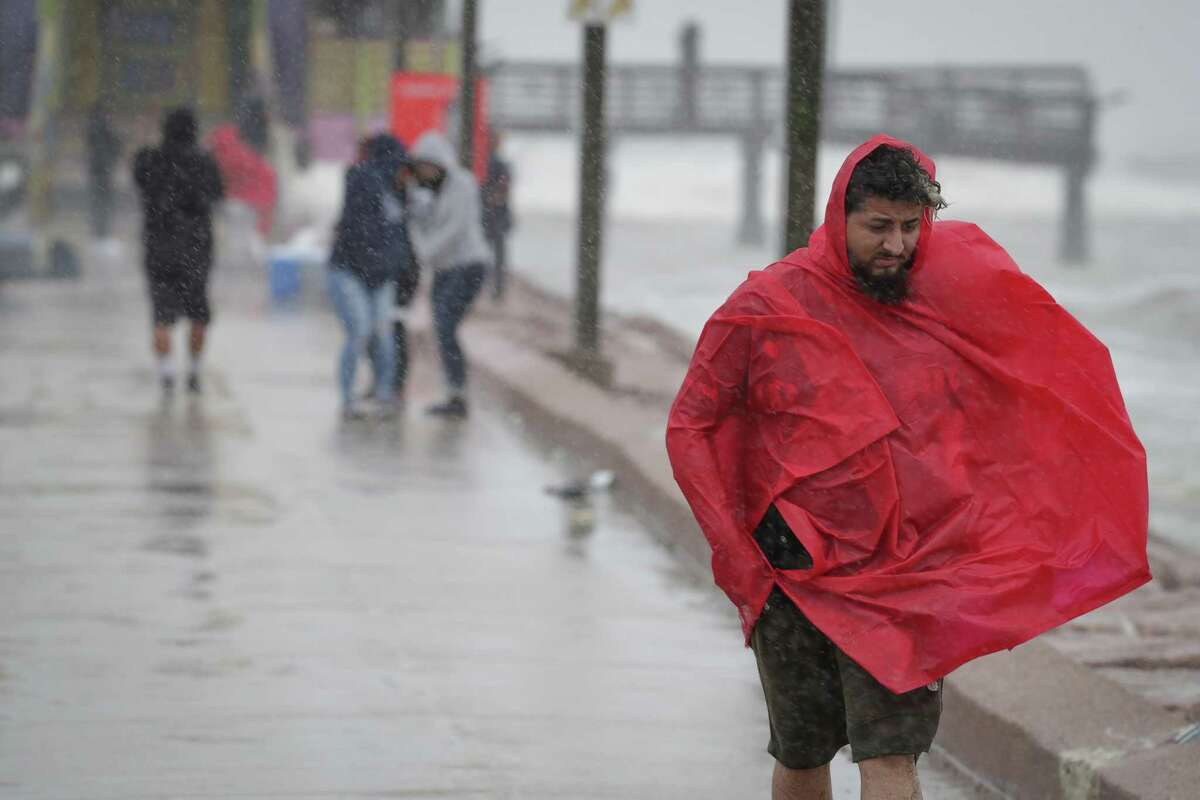 Edgar Yanez battles the wind and rain as he headed off the 61st Street Pier as Tropical Storm Beta approaches Sunday, Sept. 20, 2020, in Galveston.