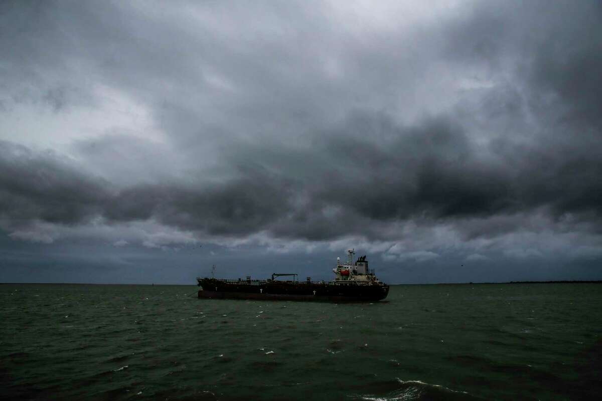 Storm clouds brew over a cargo ship as Tropical Storm Cindy approaches the coast Wednesday, June 21, 2017 on the Bolivar Peninsula.