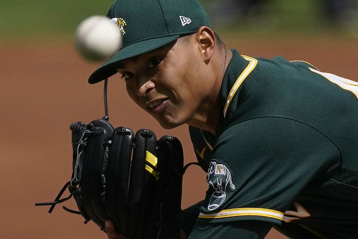 Oakland Athletics starting pitcher Jesus Luzardo (44) throws during the first inning of a spring training baseball game against the Arizona Diamondbacks Tuesday, March 16, 2021, in Scottdale, Ariz. (AP Photo/Ashley Landis)