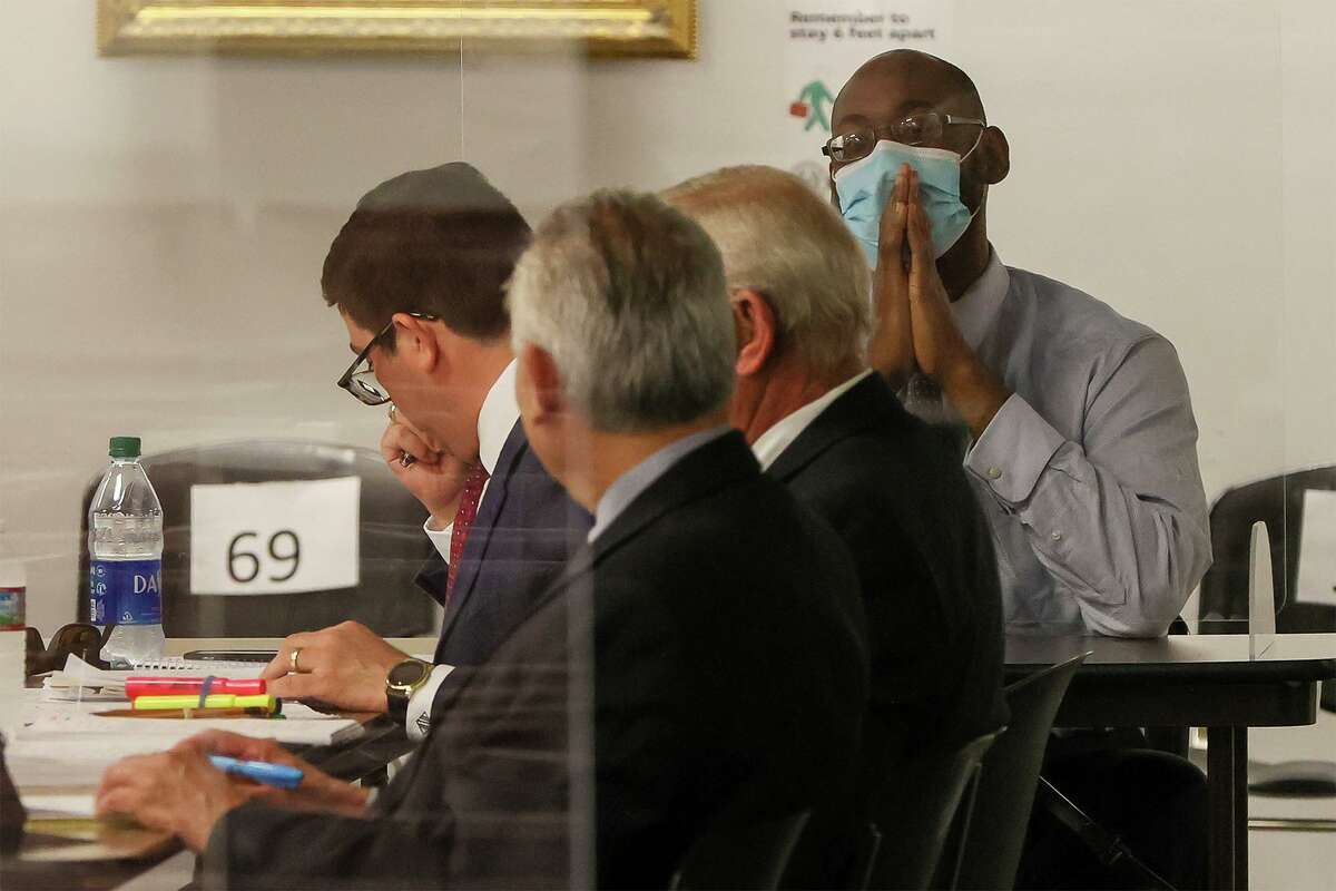 Otis McKane, right, sits with defense attorneys during individual jury selection for his capital murder trial in the Central Jury Room on Monday, March 22, 2021.
