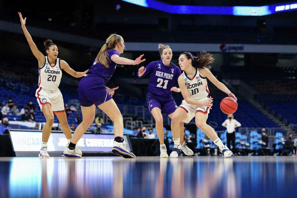 UConn's Nika Muhl (10) dribbles around High Point's Skyler Curran during Sunday's NCAA Tournament game in San Antonio.