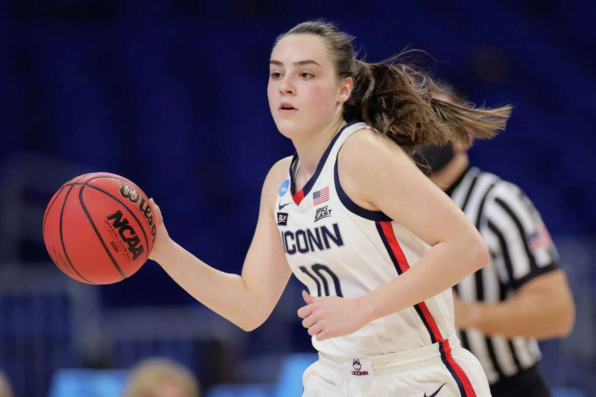 SAN ANTONIO, TEXAS - MARCH 21: Nika Muhl #10 of the UConn Huskies controls the ball against the High Point Panthers during the first half in the first round game of the 2021 NCAA Women's Basketball Tournament at the Alamodome on March 21, 2021 in San Antonio, Texas. (Photo by Carmen Mandato/Getty Images)