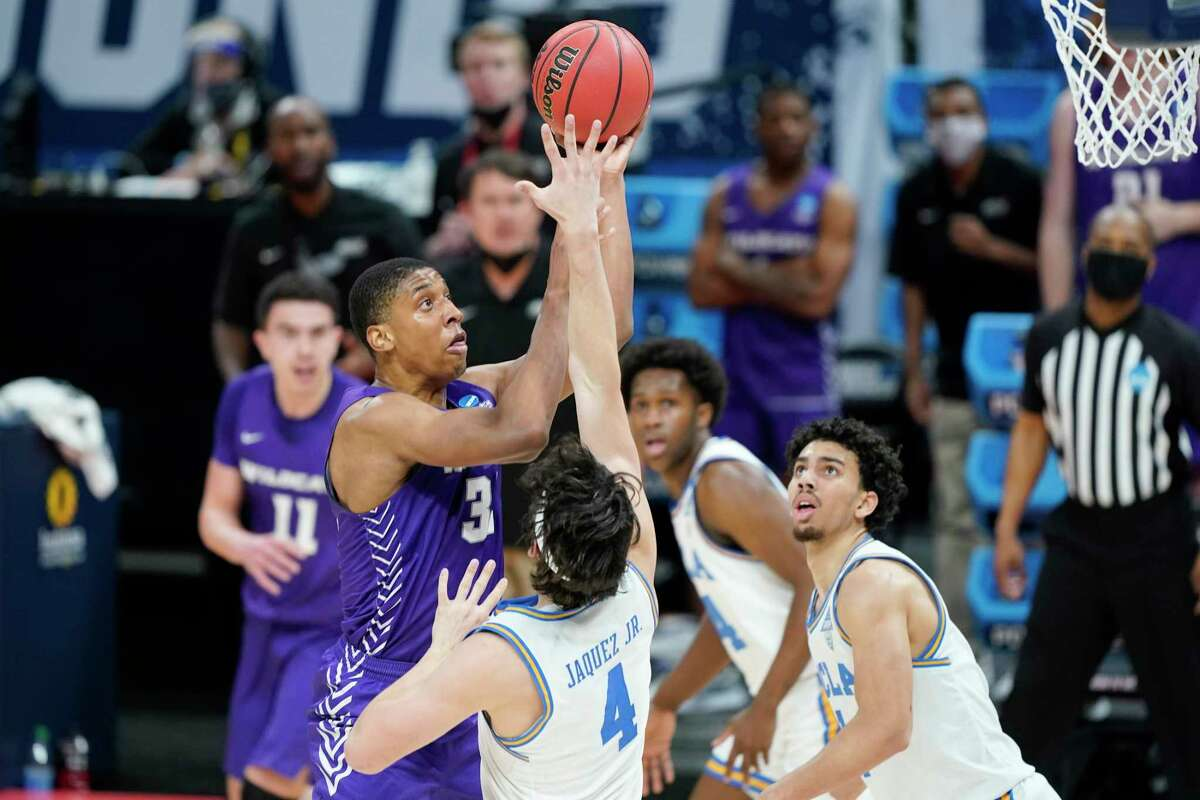 Abilene Christian's Joe Pleasant (32) shoots over UCLA's Jaime Jaquez Jr. (4) during the second half of a college basketball game in the second round of the NCAA tournament at Bankers Life Fieldhouse in Indianapolis Monday, March 22, 2021.