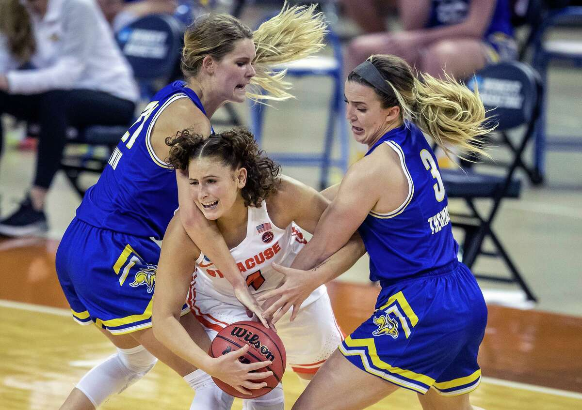 Syracuse guard Tiana Mangakahia (4) is fouled by South Dakota State's Lindsey Theuninck (3) and Tylee Irwin (21) during Sunday's NCAA Tournament game in Austin.